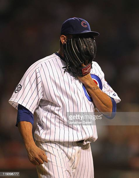 Starting pitcher Matt Garza of the Chicago Cubs yells into his glove after being taken out of a game against the Philadelphia Phillies at Wrigley...