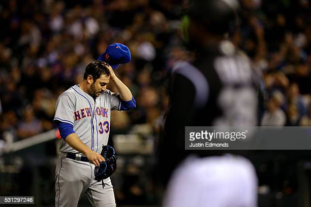Starting pitcher Matt Harvey of the New York Mets walks faff the field scratching his head after being pulled from the game with two outs in the...