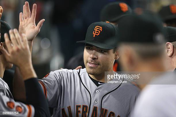 Starting pitcher Matt Moore of the San Francisco Giants is congratulated in the dugout by teamates after Corey Seager of the Los Angeles Dodgers...
