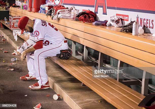 Starting pitcher Matt Shoemaker of the Los Angeles Angels of Anaheim sits in the dugout during the fifth inning of the game against the Seattle...