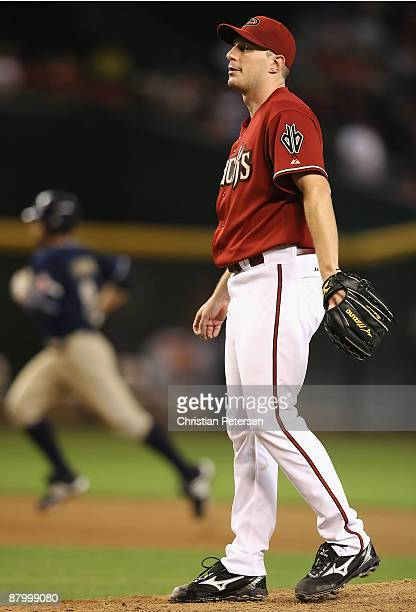 Starting pitcher Max Scherzer of the Arizona Diamondbacks reacts after giving up a solo home run to Chris Burke of the San Diego Padres during the...