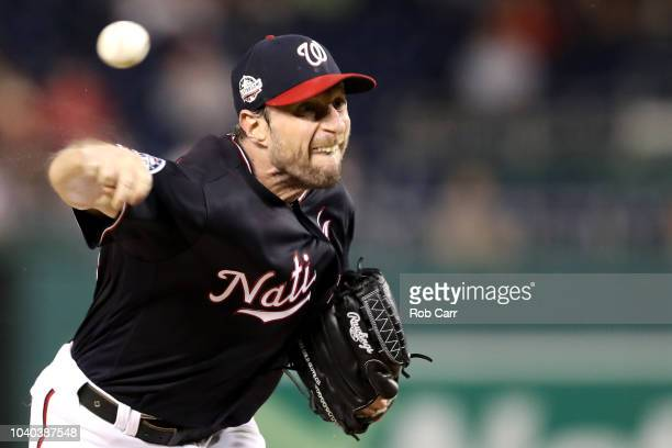 Starting pitcher Max Scherzer of the Washington Nationals throws a third inning pitch against the Miami Marlins at Nationals Park on September 25...