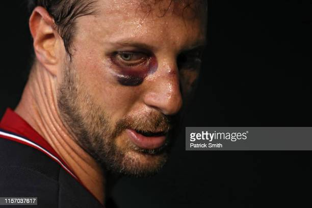 Starting pitcher Max Scherzer of the Washington Nationals walks into the clubhouse during the fourth inning against the Philadelphia Phillies in game...