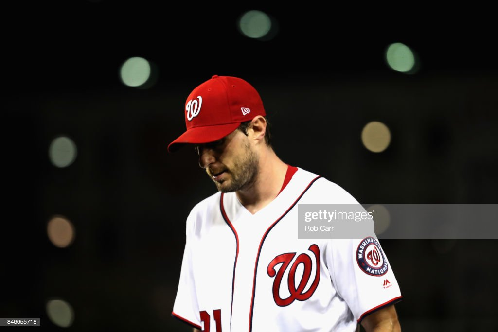 Starting pitcher Max Scherzer #31 of the Washington Nationals walks off the field at in the sixth inning against the Atlanta Braves at Nationals Park on September 13, 2017 in Washington, DC.