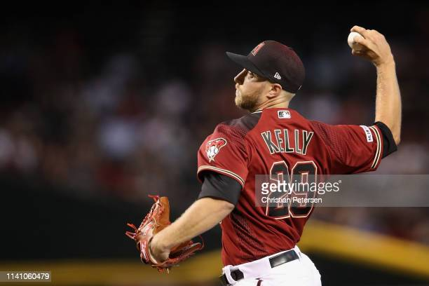 Starting pitcher Merrill Kelly of the Arizona Diamondbacks pitches against the Boston Red Sox during the first inning of the MLB game at Chase Field...