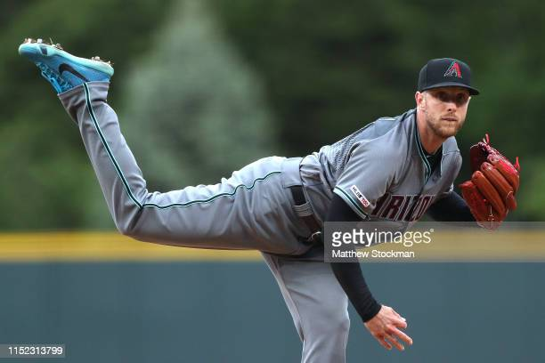 Starting pitcher Merrill Kelly of the Arizona Diamondbacks throws in the first inning against the Colorado Rockies at Coors Field on May 28 2019 in...