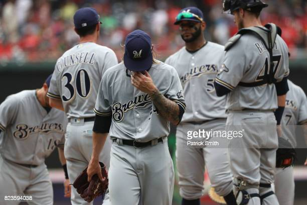Starting pitcher Michael Blazek of the Milwaukee Brewers is relived in the third inning against the Washington Nationals at Nationals Park on July 27...