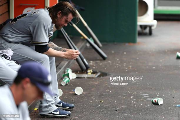Starting pitcher Michael Blazek of the Milwaukee Brewers looks on from the dugout after being relived in the third inning against the Washington...