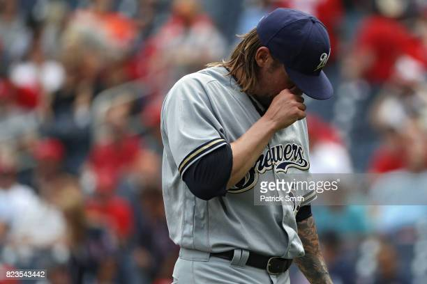 Starting pitcher Michael Blazek of the Milwaukee Brewers walks off of the mound following the first inning against the Washington Nationals at...