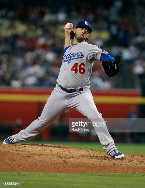 Starting pitcher Mike Bolsinger of the Los Angeles Dodgers throws against the Arizona Diamondbacks during the first inning of a MLB game at Chase...