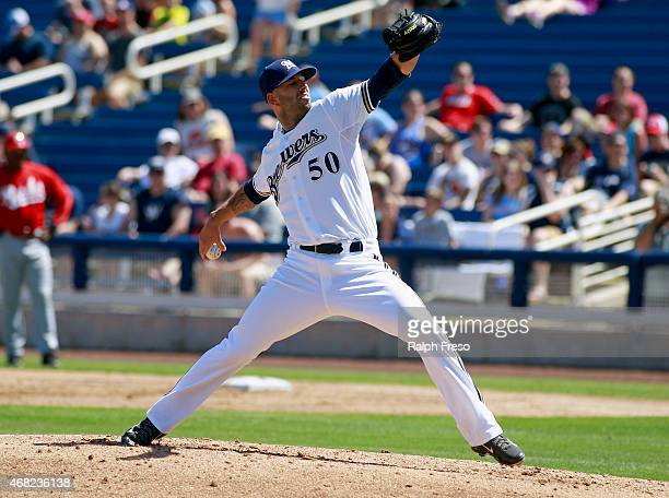 Starting pitcher Mike Fiers of the Milwaukee Brewers delivers a pitch against the Cincinnati Reds during the second inning of a Cactus League spring...