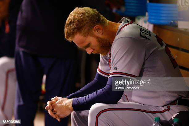 Starting pitcher Mike Foltynewicz of the Atlanta Braves sits in the dugout after being removed from the game after allowing eight earned runs in...