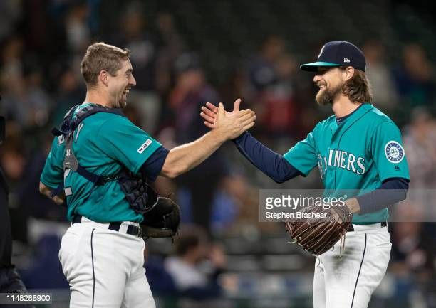 Starting pitcher Mike Leake of the Seattle Mariners and catcher Tom Murphy of the Seattle Mariners celebrate after a game against the Houston Astros...