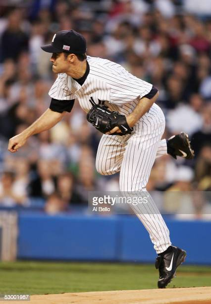Starting pitcher Mike Mussina of the New York Yankees delivers during the first inning of the game at Yankee Stadium on May 29 2005 in the Bronx...