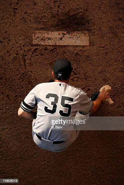 Starting pitcher Mike Mussina of the New York Yankees grabs the chalk bag before warming up in the bullpen before a game against the Colorado Rockies...