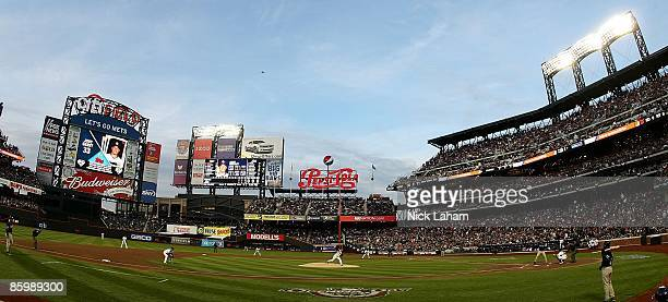 Starting pitcher Mike Pelfrey of the New York Mets throws out the first pitch against the San Diego Padres during opening day at Citi Field on April...