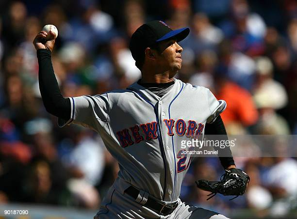 Starting pitcher Nelson Figueroa of the New York Mets delivers the ball against the Chicago Cubs on August 30 2009 at Wrigley Field in Chicago...