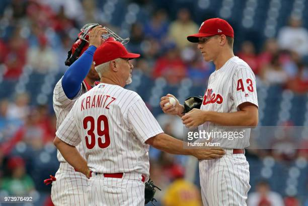 Starting pitcher Nick Pivetta of the Philadelphia Phillies speaks with pitching coach Rick Kranitz in the first inning during a game against the...