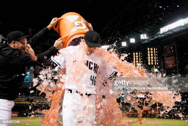 Starting pitcher Patrick Corbin of the Arizona Diamondbacks gets doused in Gatorade after pitching a complete game shutout against the San Francisco...