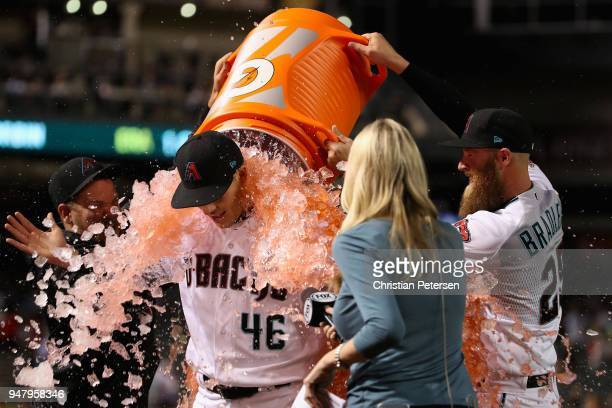 Starting pitcher Patrick Corbin of the Arizona Diamondbacks is dunked with gatorade by Andrew Chafin and Archie Bradley after pitching a compete game...