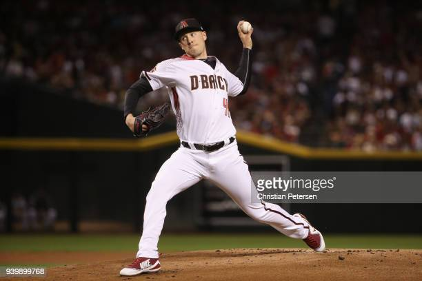 Starting pitcher Patrick Corbin of the Arizona Diamondbacks pitches against the Colorado Rockies during the first inning of the opening day MLB game...