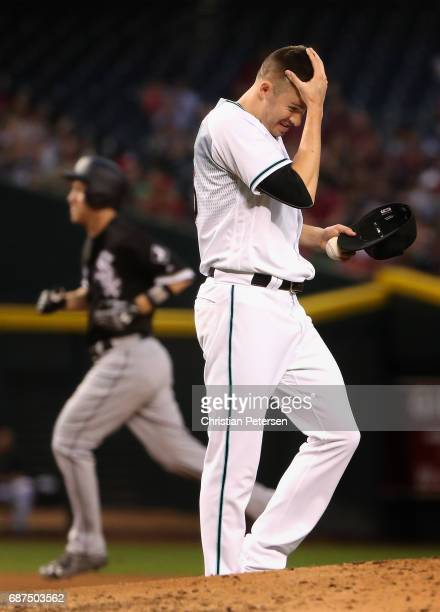 Starting pitcher Patrick Corbin of the Arizona Diamondbacks reacts after giving up a two run home run to Todd Frazier of the Chicago White Sox during...