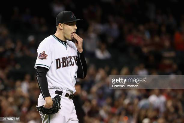 Starting pitcher Patrick Corbin of the Arizona Diamondbacks reacts after giving up a single to the San Francisco Giants during the eighth inning of...
