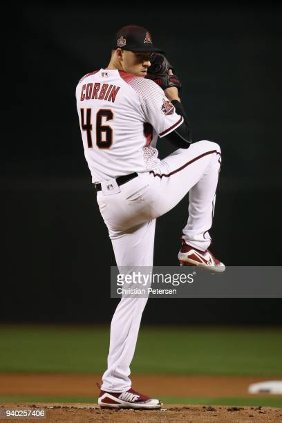 Starting pitcher Patrick Corbin of the Arizona Diamondbacks throws a warm up pitch during the first inning of the opening day MLB game against the...
