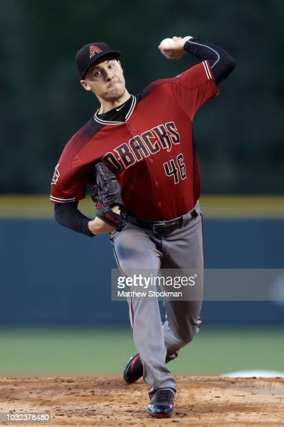 Starting pitcher Patrick Corbin of the Arizona Diamondbacks throws in the first inning against the Colorado Rockies at Coors Field on September 12...