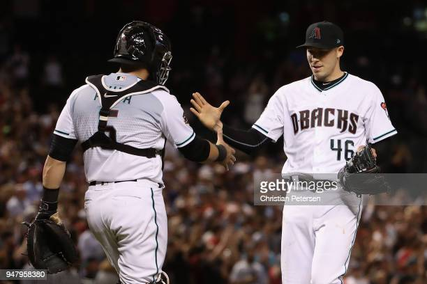 Starting pitcher Patrick Corbin of the Arizona Diamondbacks celebrates with catcher Alex Avila after pitching a compete game shutout against the San...