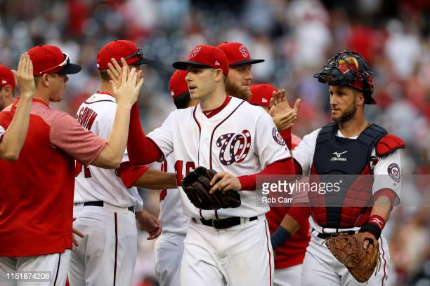 Starting pitcher Patrick Corbin of the Washington Nationals celebrates with teammates after throwing a complete game shutout against the Miami...