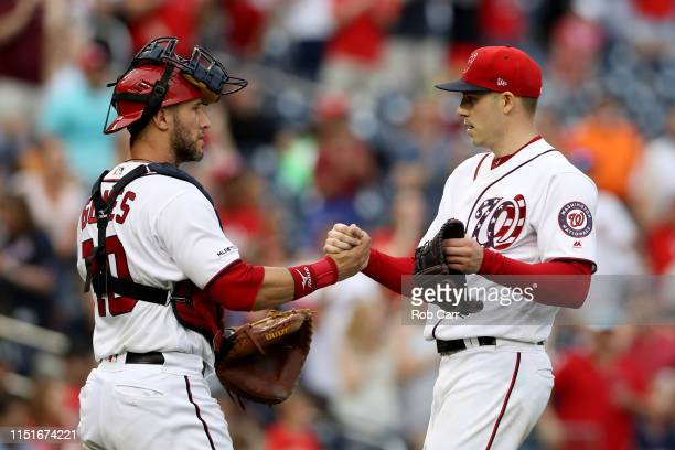 Starting pitcher Patrick Corbin of the Washington Nationals celebrates with catcher Yan Gomes after throwing a complete game shutout against the...
