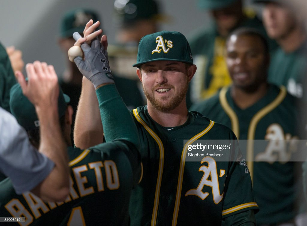 Starting pitcher Paul Blackburn #58 of the Oakland Athletics is congratulated by teammates in the dugout after being relieved in a game against the Seattle Mariners at Safeco Field on July 6, 2017 in Seattle, Washington.