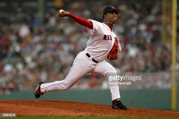 Starting pitcher Pedro Martinez of the Boston Red Sox delviers a pitch as he was credited with the loss as the New York Yankees defeated the Boston...