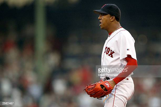 Starting pitcher Pedro Martinez of the Boston Red Sox has words for Karim Garcia of the New York Yankees after he slid into Todd Walker at second...