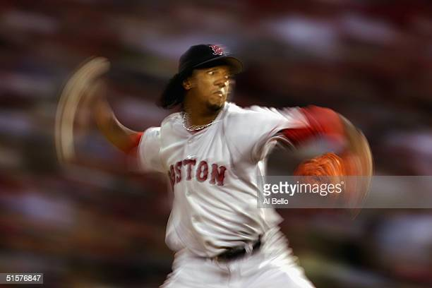 Starting pitcher Pedro Martinez of the Boston Red Sox throws a pitch against the St Louis Cardinals during the first inning of game three of the...