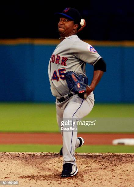 Starting pitcher Pedro Martinez of the New York Mets pitches in the first inning against the Florida Marlins at Dolphin Stadium on April 1 2008 in...