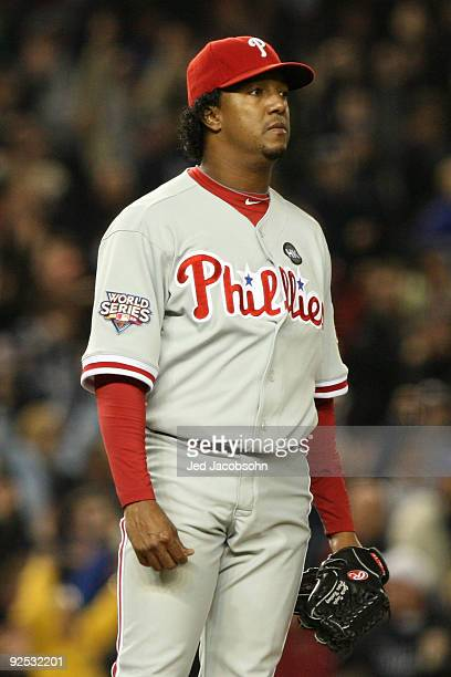 Starting pitcher Pedro Martinez of the Philadelphia Phillies looks on after giving up a home run in the sixth inning against the New York Yankees in...