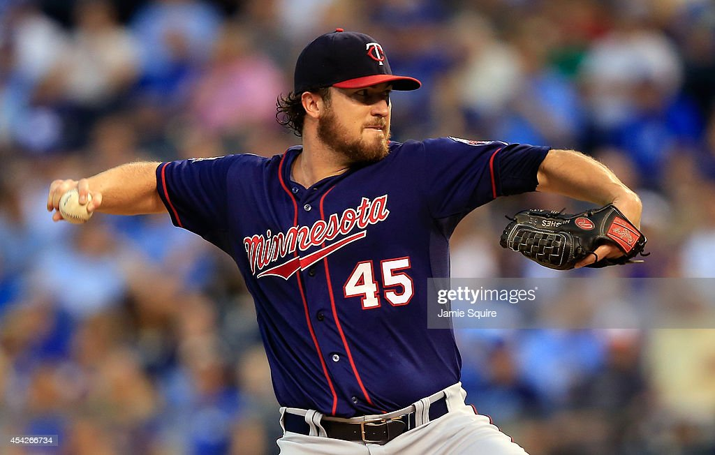 Starting pitcher Phil Hughes #45 of the Minnesota Twins pitches during the game against the Kansas City Royals at Kauffman Stadium on August 27, 2014 in Kansas City, Missouri.