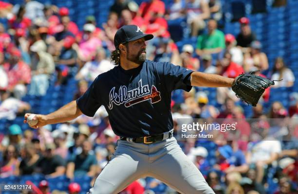 Starting pitcher RA Dickey of the Atlanta Braves throws a pitch in the first inning during a game against the Philadelphia Phillies at Citizens Bank...