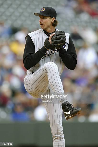 Starting pitcher Randy Johnson of the Arizona Diamondbacks delivers a pitch during the game against the Colorado Rockies at Coors Field on April 5,...