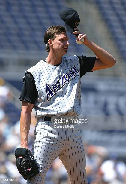 Starting pitcher Randy Johnson of the Arizona Diamondbacks reacts after giving up a hit during the MLB game at Qualcomm Stadium on July 20, 2003 in...