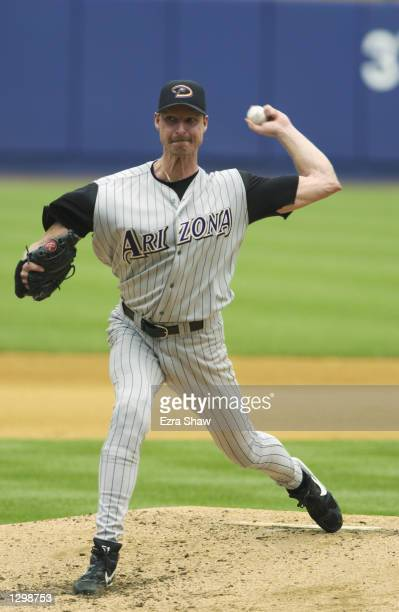 Starting Pitcher Randy Johnson of the Arizona Diamondbacks throws against the New York Mets on August 5, 2002 at Shea Stadium in Flushing, New York....