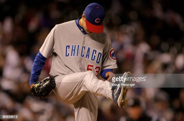 Starting pitcher Rich Hill of the Chicago Cubs kicks the mound as manager Lou Piniella heads to the mound to remove him in the sixth inning against...
