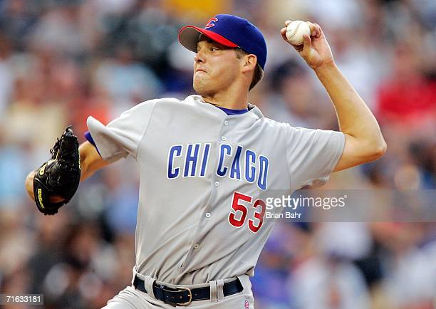 Starting pitcher Rich Hill of the Chicago Cubs throws against the Colorado Rockies in the first inning August 11 2006 at Coors Field in Denver...