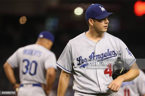 Starting pitcher Rich Hill of the Los Angeles Dodgers is removed by manager Dave Roberts during the fourth inning of the MLB game at Chase Field on...