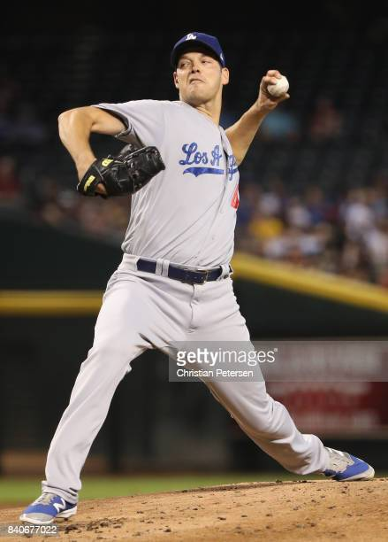 Starting pitcher Rich Hill of the Los Angeles Dodgers pitches against the Arizona Diamondbacks during the first inning of the MLB game at Chase Field...