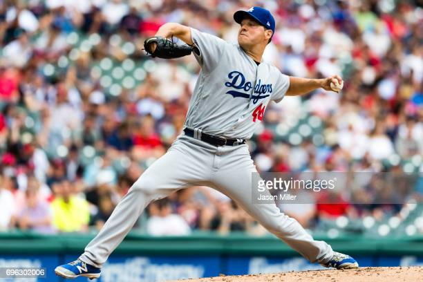 Starting pitcher Rich Hill of the Los Angeles Dodgers pitches during the first inning against the Cleveland Indians at Progressive Field on June 15...