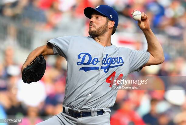 Starting pitcher Rich Hill of the Los Angeles Dodgers pitches in the first inning of Game Four of the National League Division Series against the...