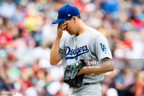 Starting pitcher Rich Hill of the Los Angeles Dodgers reacts as he leaves the game during the fifth inning against the Cleveland Indians at...